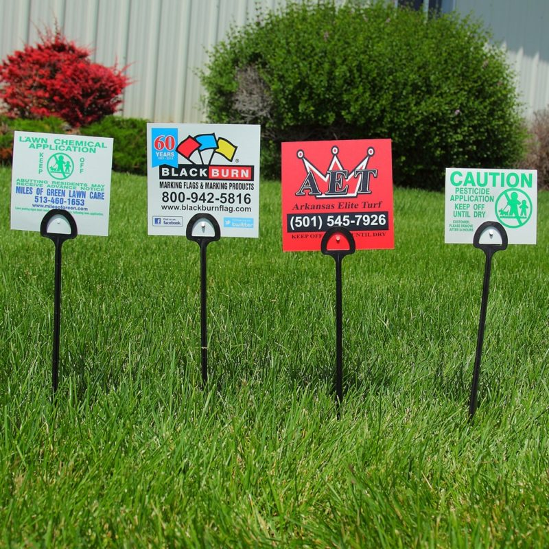 Row of BMC custom yard marketing signs with step stakes